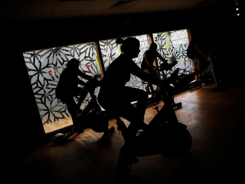People are working out in the shadows.