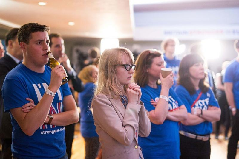 Supporters of the 'Stronger In' Campaign watch the results of the EU referendum being announced at a results party at the Royal Festival Hall in London on Friday.