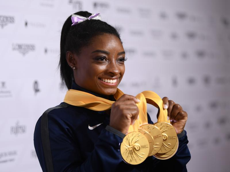 U.S. gymnast Simone Biles poses with her five gold meals at the 2019 World Championships in Stuttgart, Germany. With her wins, she becomes the most decorated gymnast ever at the world championships, with 25 total medals.