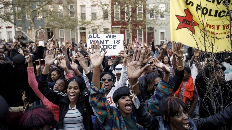 Protesters rally after a march for Freddie Gray that ended in front of the Baltimore Police Department's Western District police station Tuesday. Gray, 25, died from spinal injuries on April 19, one week after being arrested.