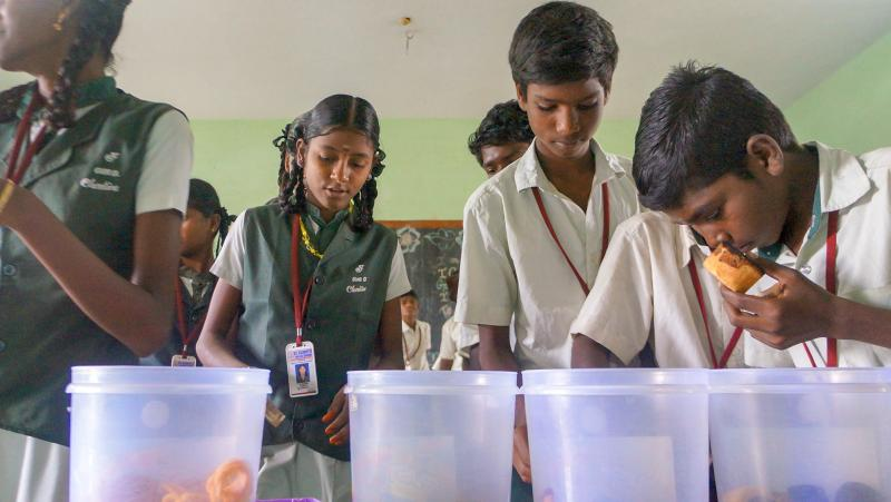 Children select a snack at St Claret's school in the southern Indian village of Karumathur. And then it's up to them whether to do the right thing and pay up.