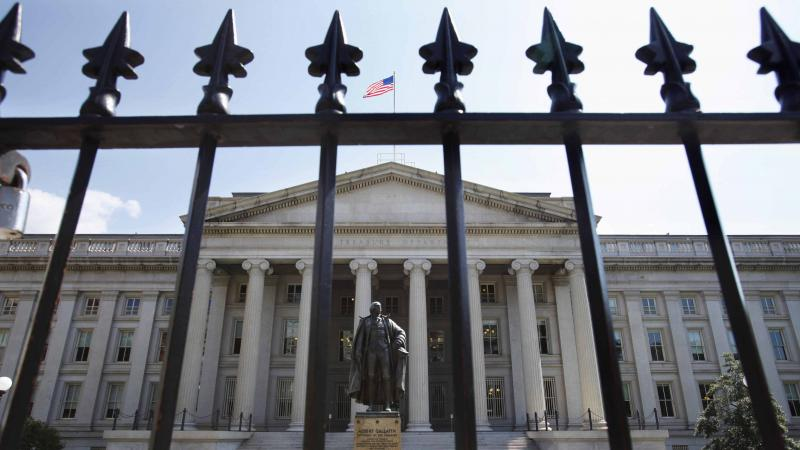 A statue of former Treasury Secretary Albert Gallatin stands guard outside the Treasury Building in Washington. Trump's campaign plans for a total overhaul of the U.S. tax code — while maintaining the revenues flowing into the federal government — may