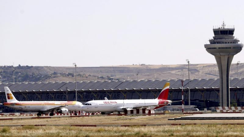 Two Spanish Iberia airplanes stand on the tarmac at the Adolfo Suarez Madrid-Barajas airport in Madrid on Monday. Spanish air traffic controllers started a four-day partial strike that could affect some 5,300 flights.