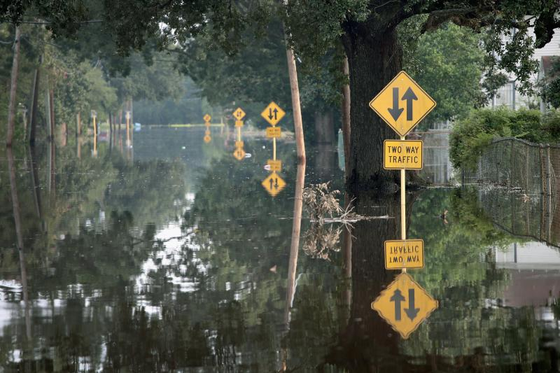 A flooded street in Orange, Texas in 2017. Climate-driven extreme rain and sea level rise, coupled with development in flood-prone areas, have led to more competition for limited federal flood mitigation dollars.