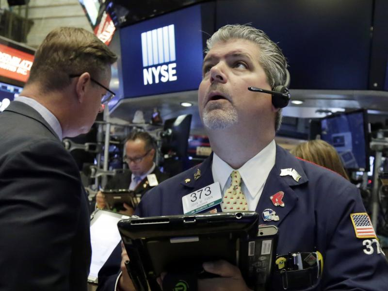 Trader John Panin works on the floor of the New York Stock Exchange on Tuesday. U.S. stock markets fell as U.S.-China trade tensions grew.