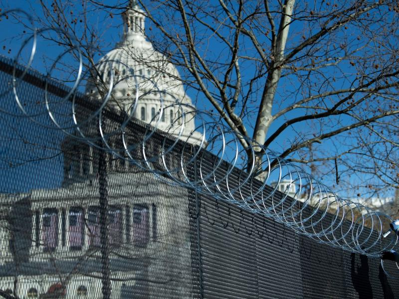 Enhanced security measures, among them razor wire atop a security fence surrounding the U.S. Capitol, are being implemented across the nation in preparation for next week's presidential inauguration.