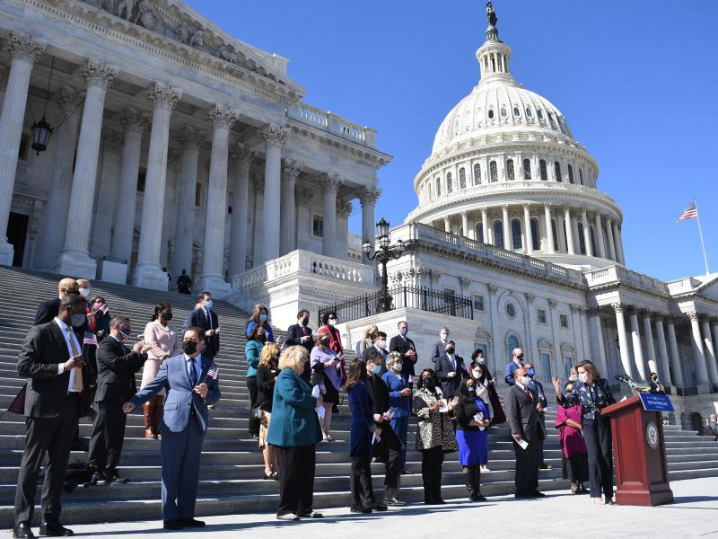 House Speaker Nancy Pelosi (right) speaks outside the U.S. Capitol in March with other members of the U.S. House of Representatives, the size of which has stayed at 435 voting members for decades.