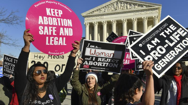 Demonstrators on both sides of the abortion debate rally outside the U.S. Supreme Court on Jan. 19, 2018.