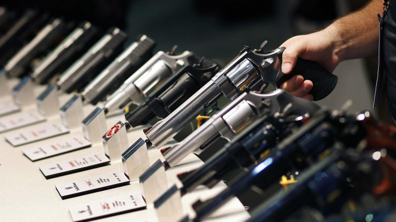 Handguns are displayed at a trade show in Las Vegas. The Supreme Court is granting a case on gun rights for the first time since 2010.