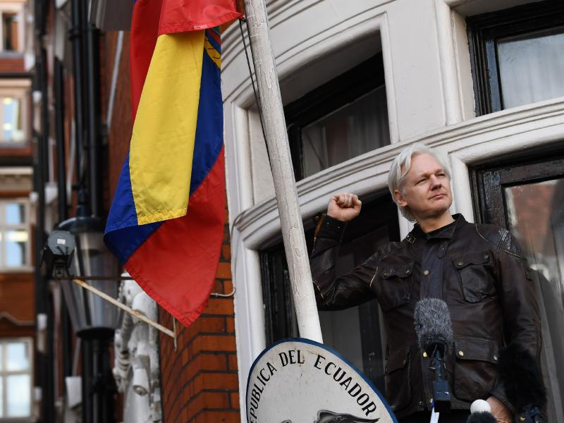 "WikiLeaks founder Julian Assange raises his fist before addressing reporters from the balcony of the Ecuadorian Embassy in London on Friday. In his speech, Assange said there are still plenty of legal battles still to wage: ""The proper war is just commenc"