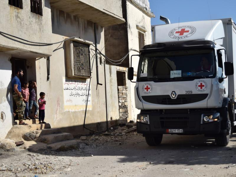 A Red Cross vehicle carrying aid arrives in the rebel-held town of Talbiseh, Syria, on Monday.