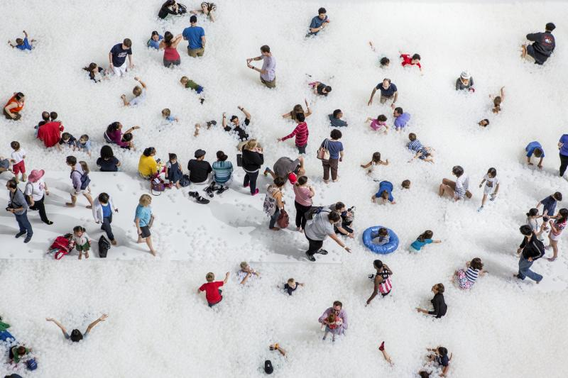 "Museumgoers play in the 10,000-square-foot exhibition called ""The Beach"" at the National Building Museum in Washington, D.C."