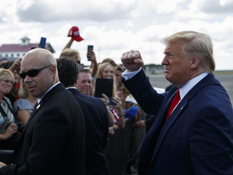 President Trump greets supporters after arriving at Florida's Ocala International Airport on Thursday to give a speech on health care at The Villages retirement community. In his speech, Trump gave seniors a pep talk about what he wants to do for Medicare