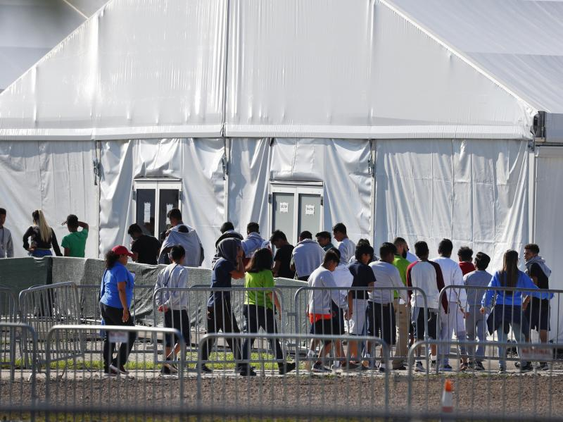 Children line up in February 2018 to enter a tent at the Homestead Temporary Shelter for Unaccompanied Children in Homestead, Fla. Many of these kids were taken from their parents after crossing the border illegally.