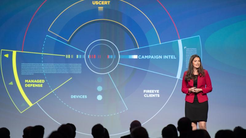 Sandra Joyce, the head of global intelligence at the cybersecurity firm FireEye, speaks at the company's Cyber Defense Summit in 2018. Private tech companies are increasingly taking the lead in reporting information about suspected attacks by foreign acto