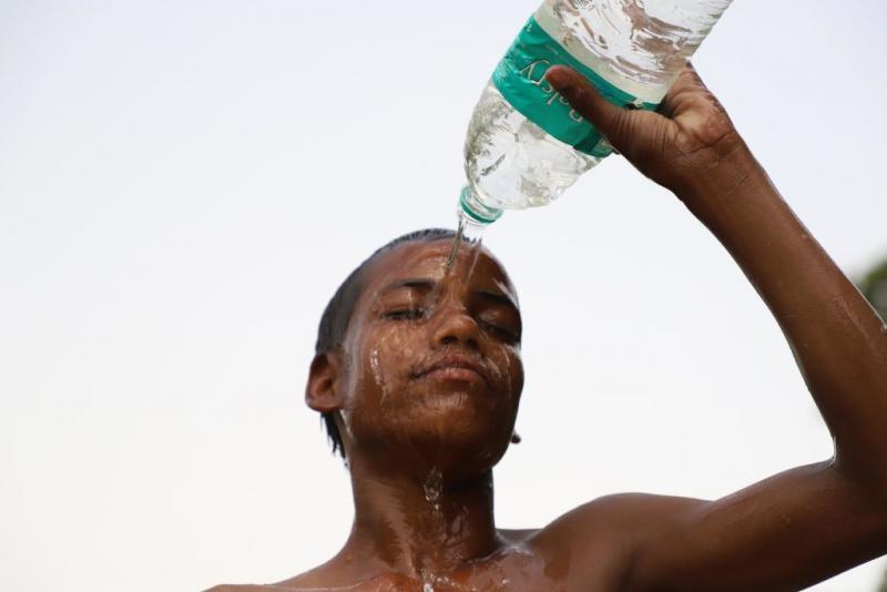 A kid tries to beat the heat in New Delhi on June 15. The changing climate is especially brutal in India. Temperatures are soaring. Asphalt roads are melting. People are dying.