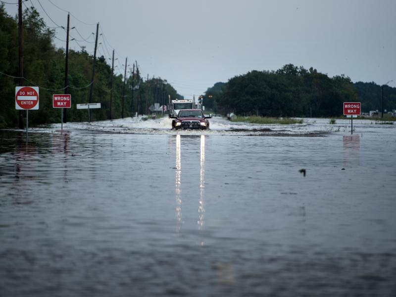 A flooded road leading to the Arkema chemical plant near Houston, Texas in August 2017. Multiple employees including the plant manager are facing criminal charges for allegedly failing to adequately prepare for flooding that caused massive chemical fires
