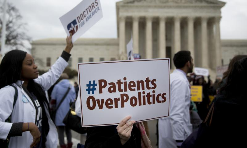 Demonstrators from Doctors for America marched in support of the Affordable Care Act outside the U.S. Supreme Court in March 2015. Now, another case aims to undo the federal health law: Texas v. United States could land in front of the Supreme Court ahead