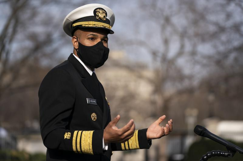 Dr. Jerome Adams, then the U.S. surgeon general, talks to reporters at the White House in December.