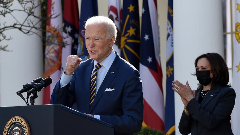 President Biden, with Vice President Harris behind him, speaks about the American Rescue Plan in the Rose Garden of the White House on Friday.