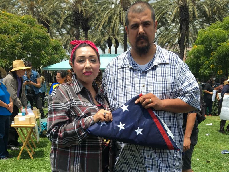 At a recent anti-Donald Trump protest in Anaheim, California, this couple said they saved the U.S. flag from a Trump supporter who was trying to get Latinos to trample it. Nervous about giving their full names, he said his was Anthony, and she said she wa