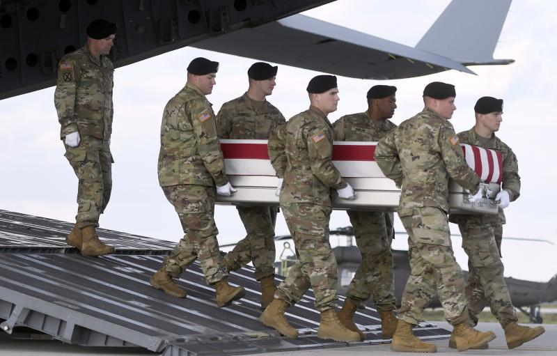 An Army team at Dover Air Force Base, Del., carries a transfer case containing the remains of Sgt. 1st Class Hughton O. Brown on Nov. 16.