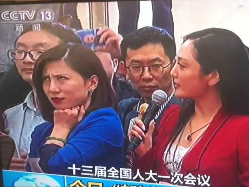 A screenshot of Liang Xiangyi, a financial news reporter, who was so disgusted by a fellow reporter's softball question to a government official at this week's National People's Congress that she was caught on live television rolling her eyes. The moment