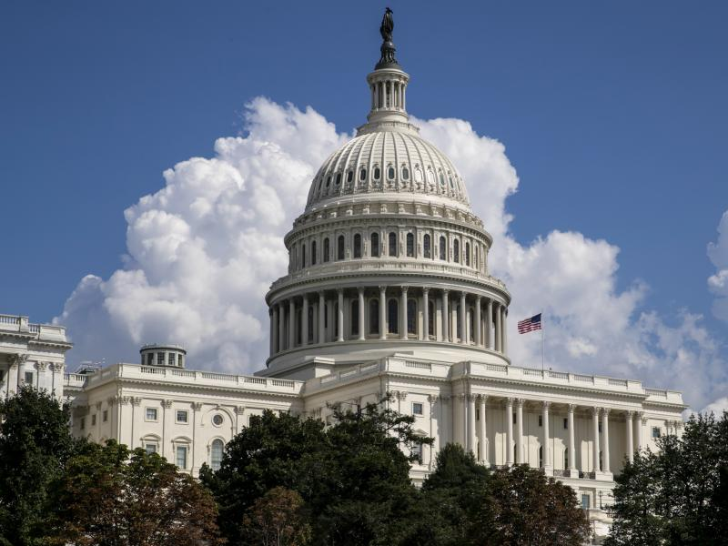The federal budget deficit is expected to grow to $960 billion this year, the Congressional Budget Office said.