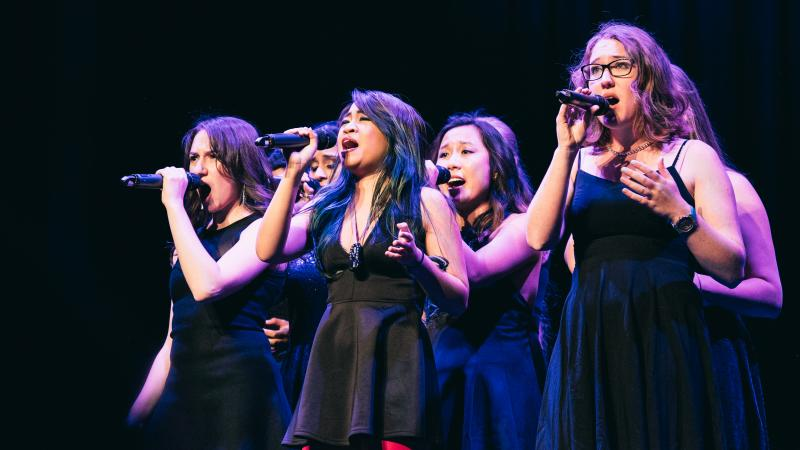 Voices In Your Head, from the University of Chicago, performs their competition set. In the front, you can see Kari Wei — she's the one with the pitch pipe around her neck.