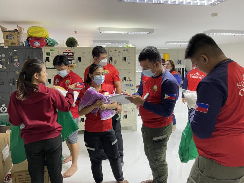 Staffers distribute the required personal protective gear before they transfer a COVID-positive patient to a hospital. They'll wear a gown, gloves, mask and face shield.