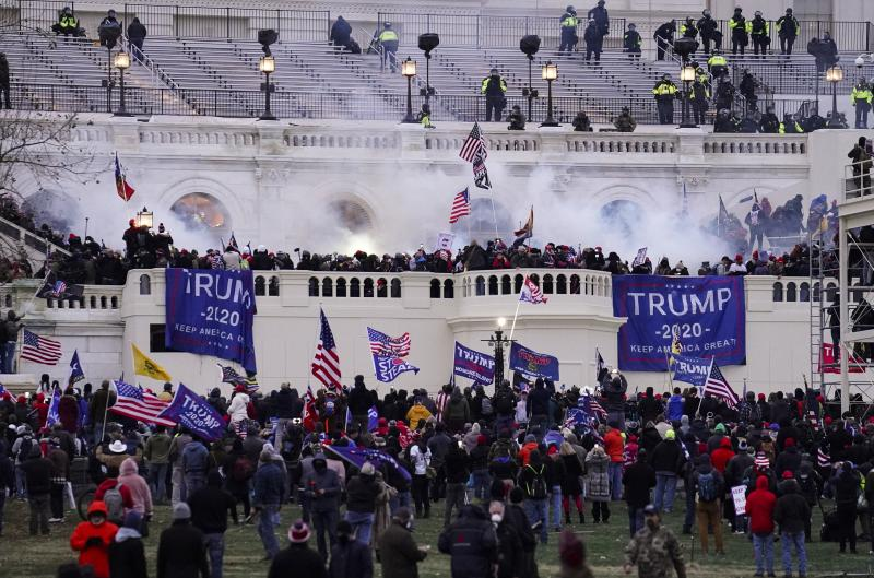 In this Wednesday, Jan. 6, 2021, file photo, rioters storm the Capitol, in Washington. In the weeks since the attacks lawmakers from both parties have clashed over creating an outside commission to investigate the riot.