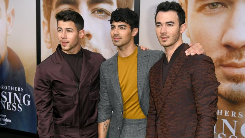 (From left) Nick, Joe and Kevin Jonas attend the premiere of the Jonas Brothers documentary, Amazon Prime Video's Chasing Happiness, in June 2019 in Los Angeles.