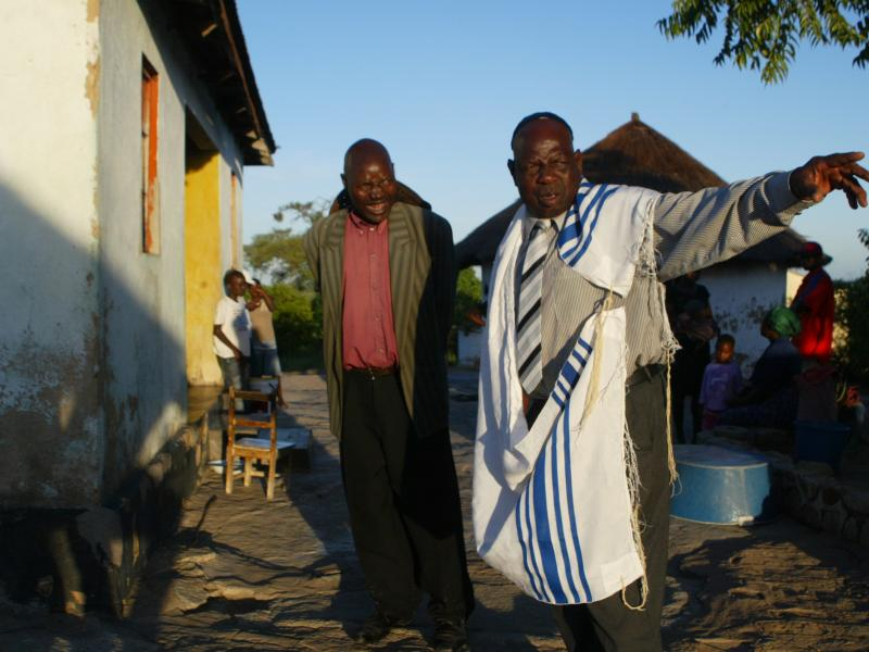 A leader of the Lemba people, wearing a prayer shawl, gathers with his fellow Jews. DNA tests have confirmed the Semitic heritage of these sub-Saharan Africans.
