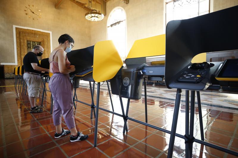 Josh Hodas and partner Serena Delgadillo cast their votes in the historic Los Angeles Union Station Ticket Hall on Monday.