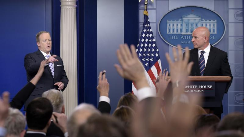 White House press secretary Sean Spicer, left, calls on a reporter during a press briefing appearance by national security adviser H.R. McMaster on Tuesday.
