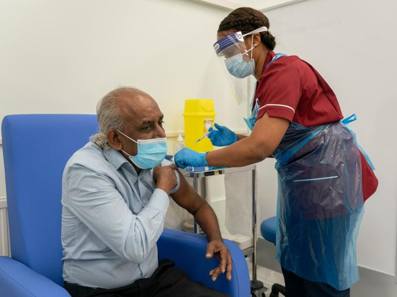 A nurse prepares to administer a COVID-19 vaccine at Croydon University Hospital in London.