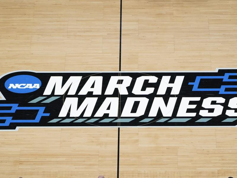 The March Madness logo is seen during a men's college basketball NCAA tournament game in Indianapolis. The Supreme Court has eroded the difference between elite college athletes and professional sports stars.