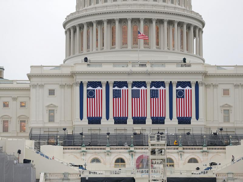 Wednesday's inauguration, coming two weeks to the day after the insurrection on the Capitol, will be unlike any other in living memory, writes NPR's Michel Martin. Above, the Capitol building is seen as workers prepare for the inauguration ceremony for Ba