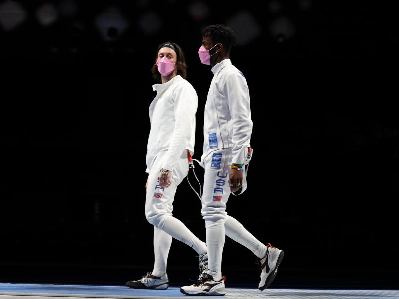 American's Jacob Hoyle and Curtis McDowald wear pink face masks after losing to Japan in Men's Épée.