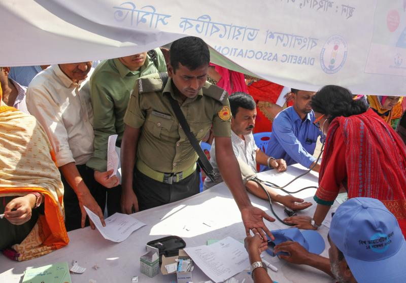 A man gets tested for diabetes at an event in Dhaka, Bangladesh, for World Diabetes Day in 2019.