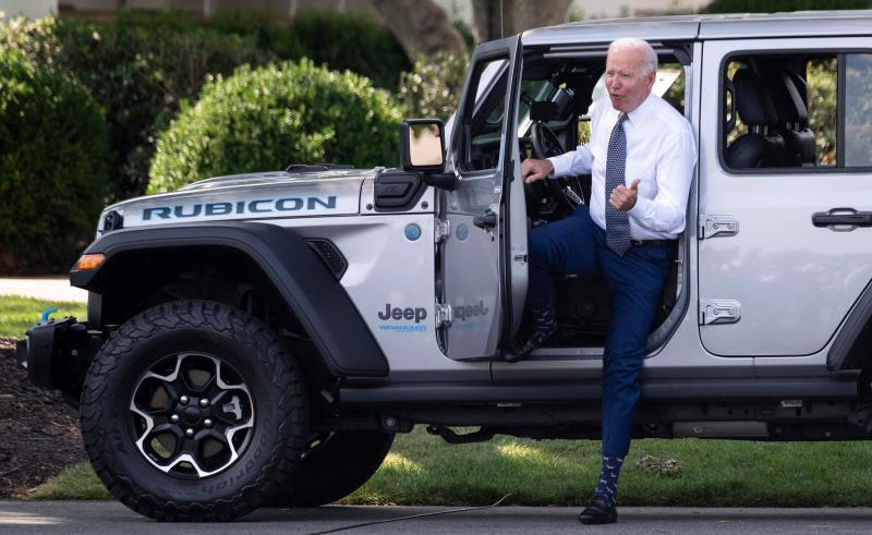 President Biden gets out of a Jeep Wrangler Rubicon 4xE after delivering remarks at the White House Thursday on electric vehicles and new fuel economy and emissions standards.