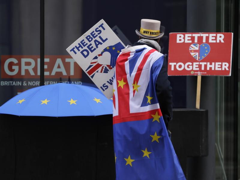 A pro-EU demonstrator sets up banners outside a London conference center, where trade talks were being held on Dec. 4.