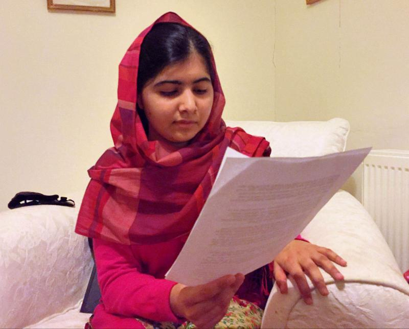 At her home in the U.K., Malala Yousafzai reads her letter to the missing Nigerian schoolgirls.
