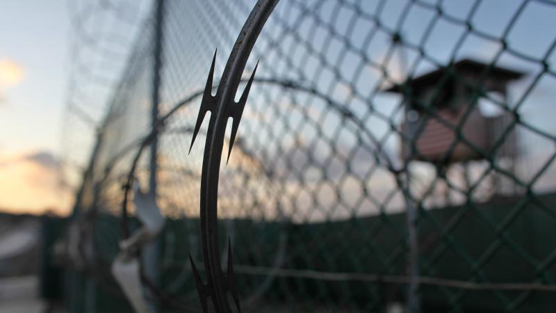 The sun rises over the detention facility at the Guantánamo Bay U.S. Naval Base in Cuba, in this May 13, 2009, photo reviewed by the U.S. military.