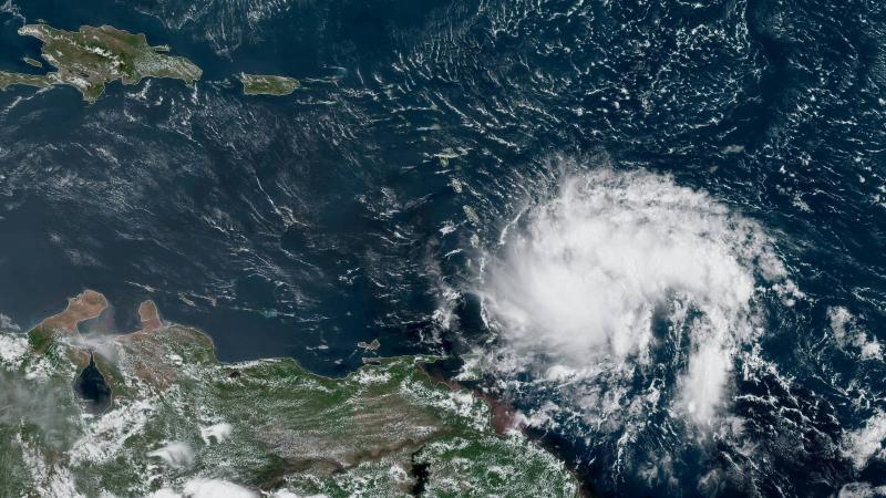 A satellite image taken Monday shows Tropical Storm Dorian heading westward toward the Caribbean Sea. The storm could become Hurricane Dorian by late Tuesday, forecasters say.