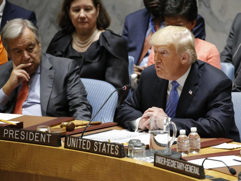 """""""Regrettably, we found that China has been attempting to interfere in our upcoming 2018 election — coming up in November — against my administration,"""" President Trump said Wednesday at a meeting of the U.N. Security Council. Looking on is U.N. Secreta"""