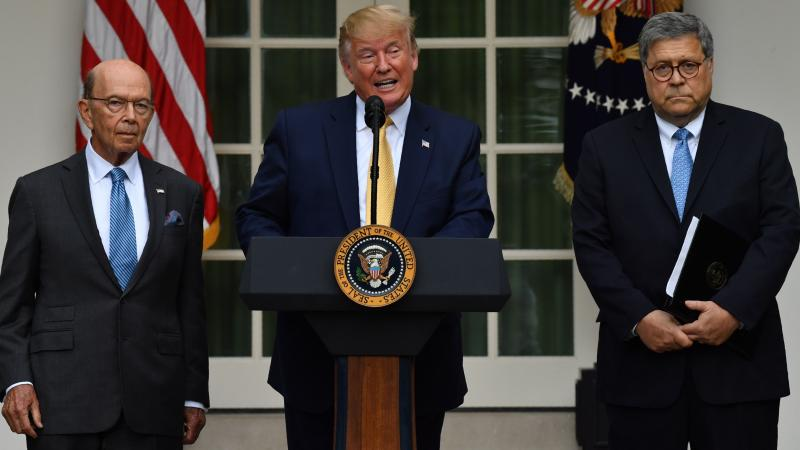 President Trump, flanked by Secretary of Commerce Wilbur Ross (left) and Attorney General William Barr, delivers remarks on citizenship and the census in the Rose Garden at the White House on Thursday.