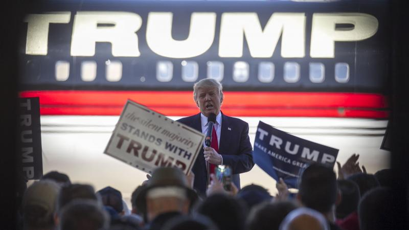 Republican presidential candidate Donald Trump speaks at a campaign rally in an airplane hangar in Bentonville, Ark., on Saturday.