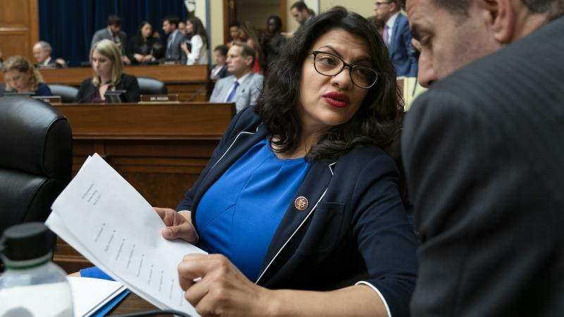 Rep. Rashida Tlaib, D-Mich., pauses as the House Oversight and Reform Committee votes on Wednesday to hold Attorney General William Barr and Commerce Secretary Wilbur Ross in contempt for failing to turn over subpoenaed documents related to the Trump admi