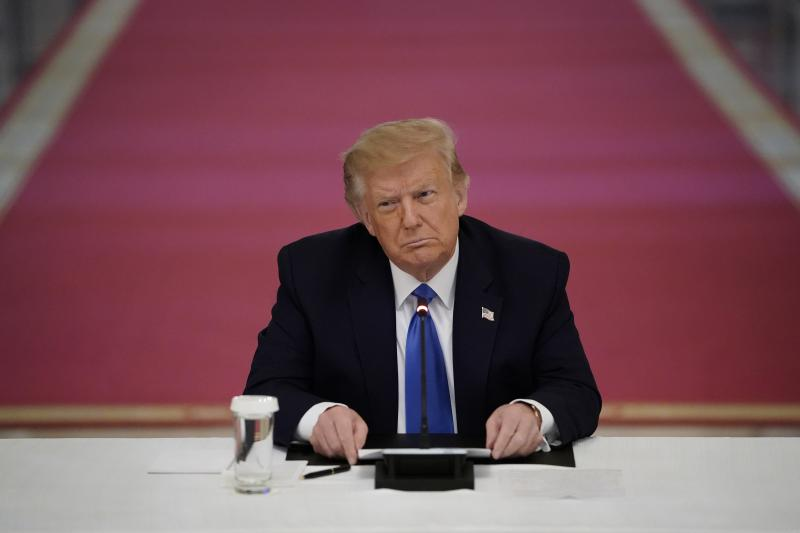 President Trump attends an event about law enforcement on Monday at the White House. Trump has repeatedly downplayed the disproportionate impact of police violence on African Americans.